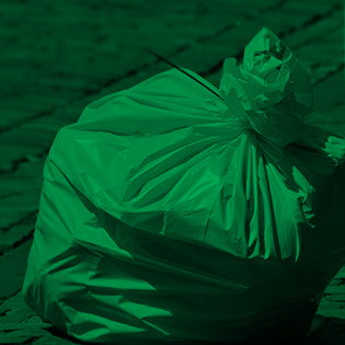 Photo of a full garbage bag with a green photo filter