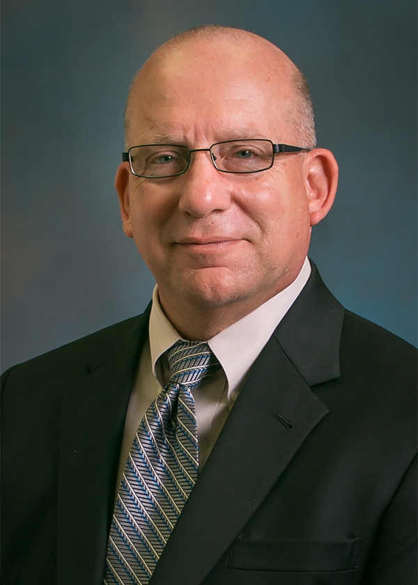 Daniel M. Grimsbo, P.E. – Executive Director of Water Utilities