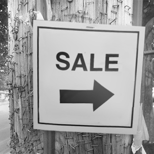 sale sign on telephone pole