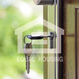 keys in door with fair housing logo