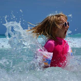 Child playing in gulf waters