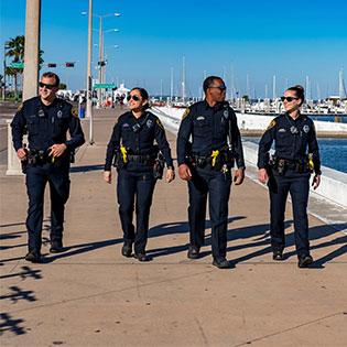 Officers walking near water
